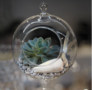 Centros de mesa esferas de cristal con decoracin con flores e car