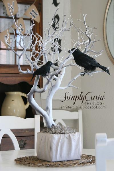 centros de mesa con ramas de arbol para halloween